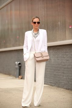 all white outfit with statement necklace