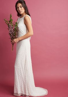 Graceful Grandeur Maxi Dress in Ivory deco-style with strands of tiny pearled beads on its sheer overlay, draped with a dramatic back cowl, and finished with a faintly high-low hemline