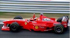 Michael Schumacher wins the 1998 Hungarian Grand Prix driving a Ferrari.