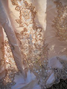 DIY $ stretching IDEA, shop thrift stores for old bridal dresses, tea stain and use the fabric, lace and trims cut apart to make table laces, decorations or?