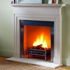 """The Dakota combines elegant proportions with crisp clean architectural lines. Carved in limestone.Shown here with the Universal fire basket, Modern steel slips and matching limestone hearth. Opening 36"""" W x 36"""" H Shelf 55"""" L x 7"""" D Overall size 48 1/2"""" W x 51 1/2"""" H Depth of jamb 3 1/2"""" Height of footblock 5"""""""
