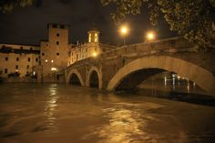 The floodwaters of the Tiber River at Pons Fabricius/Tiber Island at night. 15 November 2012.