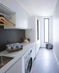 These large floor tiles are the piece-de-resistance of this stylish laundry . Home Interior, Interior Design Living Room, Living Room Designs, Design Bedroom, Modern Laundry Rooms, Laundry In Bathroom, Large Floor Tiles, Grey Floor Tiles, Black Tiles