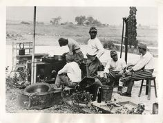 1937- Japanese soldiers wait for the cook to dish out their meal at a field kitchen near Shanghai, China.