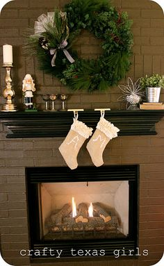 Christmas Mantle***love the wreath above the fire place!