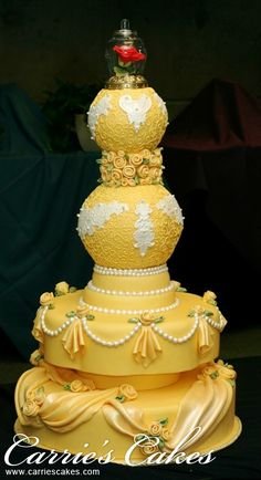 I am not sure if I really like this, but I thought it was interesting and I do like pieces of this cake. It is called the Beauty And The Beast because of the rose under the glass on the top. Oh, I bet the color is for Belle's dress. Just a guess.