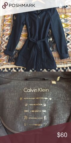 NWOT Calvin Klein Raincoat NWOT Calvin Klein raincoat with waist tie in navy blue. *Water resistant, breathable shell. *Wind protection. *Four way stretch. *Detachable hood. *Adjustable cuffs. Perfect condition. Calvin Klein Jackets & Coats