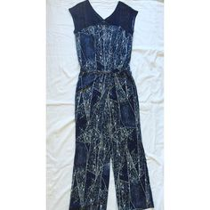 ⏬✨JUST LISTED: Cutout Yoke Patterned Jumpsuit • In like-new condition • v-neck  • navy blue & white pattern  • in second photo, I put a white sheet in between the top of the jumpsuit to better show the boho chic cutout design • silver button closure with slit on back • stretchy at waist • 2 pockets • Considering reasonable offers Pants Jumpsuits & Rompers