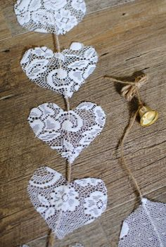 Items similar to Vertical lace hearts on a jute cord, with a gold coloured bell. Suitable to decorate wedding and party venues. on Etsy Vertical lace hearts on a jute cord, with a gold coloured bell. Suitable to decorate wedding and party venues. Wedding Crafts, Diy Wedding, Rustic Wedding, Wedding Decorations, Wedding Lace, Wedding Things, Gold Wedding Centerpieces, Wedding Bells, Wedding Reception