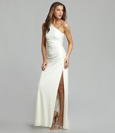 Very form fitting (you can see her belly button)...no burritos in this dress    Laundry by Shelli Segal Side-Beaded One-Shoulder Gown | Dillards.com