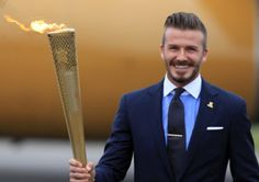David Beckham with the Olympic torch last week in Cornwall