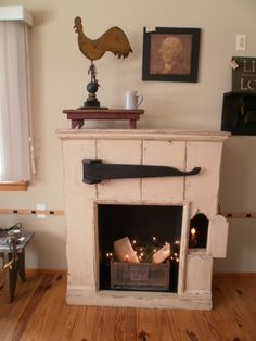 Custom sized fireplace for a electric insert , has a sweet side door that opens on right to put a candlelight in . The crane is a perfect spot to hang primitive wares on . Primitive Fireplace, Faux Fireplace Mantels, Country Fireplace, Simple Fireplace, Fireplace Seating, Candles In Fireplace, Fireplace Garden, Fireplace Cover, Fireplace Shelves