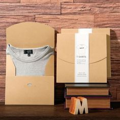 Dailytechstudios.com's selection of men's clothing, shoes, watches, and more allows you to shop for closet essentials with ease, whether you're on the hunt for a new pair of jeans, a fine watch, or new running shoes. T Shirt Packaging, Gift Packaging, Packaging Design Box, Packaging Ideas, Scarf Packaging, Paper Packaging, Cool Packaging, Packaging Design Inspiration, Tshirt Branding