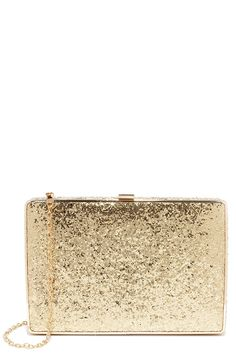 """No need to wish upon a star, the Twinkle, Twinkle Gold Glitter Clutch is already here to make your dreams come true! Glimmering gold glitter dresses up this structured, rectangular clutch with matching gold piping. Gold top clasp opens to a black fabric interior with accordion sides and single side-wall pocket. Carry as a clutch or attach the 46"""" long gold chain strap. Clutch measures 8.25"""" wide, 5.5"""" tall, and 1.5"""" deep. All vegan friendly, man made materials."""