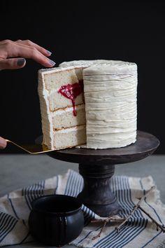 vanilla cake with swiss meringue buttercream and raspberry coulis