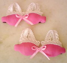 Magnets - Mini-bras made from colored dough and small bits of lace as favors at a lingerie party.