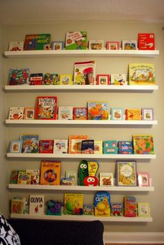I think bookshelves like this would be handy for a toddler.  This way he can see the cover of the book, instead of pulling out an entire shelf of books looking for the ONE he wants to read!