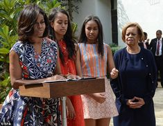 Spring break! Malia (second from left) and Sasha Obama (second from right) joined their pa...