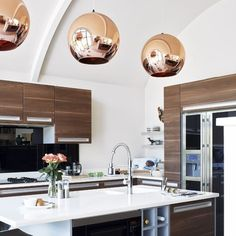 Copper pendants...want. Also...the rest of this kitchen...