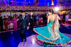 This Indian wedding reception is gorgeous with a glowing dance floor and our bride is stunning in shimmering teal!