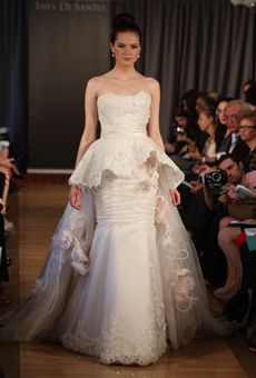 Borrowing a popular silhouette from the couture runways, waist-defining peplums injected wedding gowns with a dose of haute style using both structured and softly draped shapes.