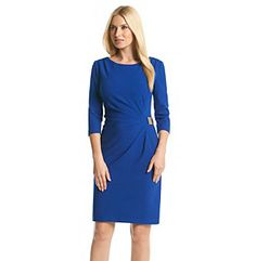 Dresses. Simple and sophisticated style can be yours when you have this ruched side dress from Jessica Howard. The side features a buckle accent at the hip. Featured in cobalt blue Boatneck -sleeves Ruched design with a buckle accent at the hip Back zipper closure Lined Hits above the knee Polyester/rayon/spandex Imported