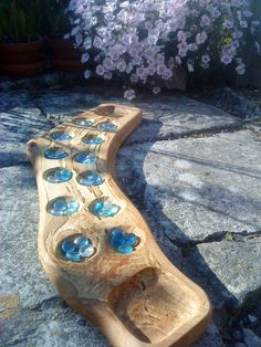 A hand-carved Mancala board in spalted lacewood. Not for sale but I have some similar wood and will accept commissions.