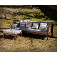 Relax in your garden in style with this chic outdoor sofa. The eucalyptus frame and slatted design ensure that this piece is quick drying and weather resistant. Gray cushions, striped and rolled pillows are made of water and soil resistant material.