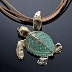 Celebrate the beauty and grace of the sea with our Loggerhead Sea Turtle Bronze Necklace by artist Anisa Stewart.