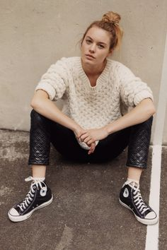sporty | Textured ivory sweater, quilted leather pants and black hightop chucks.