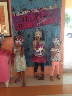 Monster High photo booth- spider table cover purchased on Halloween clearance, MH birthday banner, MH character masks printed and glued onto bamboo skewers
