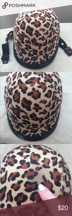 Novelty Ladies Cheetah Print Helmet This is a NON-DOT Novelty Helmet. Size Small-Medium. Cheetah print. Bought at a motorcycle rally in Laughlin. I don't know the brand. But it is a novelty helmet. Comes from a nonsmoking house with no pets. A little scuff on the very top as pointed out in photos. No box or dust cover. Other