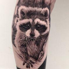 Beautiful raccoon tattoo by Ash Lewis