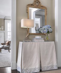 Classic traditional decor in hallway with a skirted console table.#traditionaldecor #elegantdecor #classicdecorideas