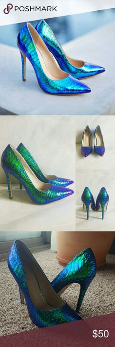 "Brand New! Mermaid Shoes! Something different. This is an eye catching style that won't be forgotten. Featuring a trendy iridescent styling and a flirty pointed toe, you?ll get all the compliments in this style.  I've only tried these on. I love them because they're so unique and eye-catching. These babies sold out in a blink when they were released! Get them before they're gone!  Shoe Details Approx. Heel Height: 4.25"" True to size JustFab Shoes Heels"