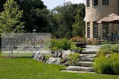 raised patio with boulders - Google Search