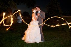Ask a wedding party member to help you take some great sparkler photos.  It's a less time-consuming and an easier alternative to the sparkler getaway.
