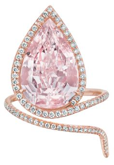 A Magnificent Fancy Pink Diamond Ring. Set with a pear-shaped natural fancy pink diamond, weighing approximately 9.01 carats