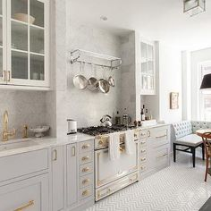 Gray French Kitchen with La Cornue Albertine Stove with Satin Chrome Polished Brass
