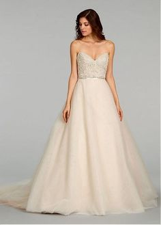 The pronunced sweetheart neckline and soft natural waistline with a strap in a-line silhouetteconstruct this classical wedding dress.And it is never out of date.The dress is made alencon lace outside and satin inside.And it suits any styles of wedding.
