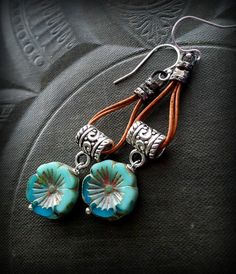 gorgeous turquoise Czech glass flowers dangle from silver tube bails, looped around twice are aged leather cord gathered at the top and finished off Leather Earrings, Leather Jewelry, Beaded Earrings, Earrings Handmade, Handmade Jewelry, Leather Cord, Ear Jewelry, Boho Jewelry, Jewelry Crafts