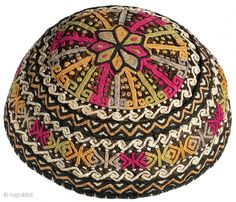 Hat. Turkmen child's cap. circa 2nd quarter 20th century. Silk embroidery on black silk; tan cotton lining; very fine embroidery; excellent ...
