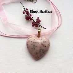 Delicate Handmade Item  * Material: Real Heather Pendant in Pink Milky Eco-Resin attached to a beautiful Pink Organza Ribbon & Cotton Necklace Cord.    * Size:  The Heart Pendant is 3.3cm at it's widest part.  The Organza Cord Necklace is 18inches (45cm)    I Love These Beautiful Blush Pendants! Must Have One!    This Exquisite and Distinctive Blush Pink Real Floral Pendant Will Make You Stand Out From The Crowd!    Pretty Heather Flowers that you have the power to freeze forever in time! A…