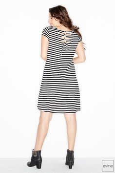 Here's a dress that's too darling to pass up. Seriously! Take a look at the back and you'll see what we mean. There's a cut-out, lace-up detail at the back neckline for a hint of skin on a hot day. So cute, right? The rest of it's just as good with a soft, striped knit design and always-feminine cap sleeves. Whether you're doing errands in sandals on a Saturday or lunch in wedges on a Wednesday, it's the perfect partner in style crime.
