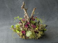 Woodland centerpiece with orchids | Françoise Weeks