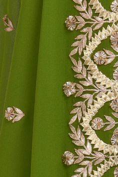 From our Wedding and Bridal Collection, this is a mehandi green pure crepe suit with intricate exquisite gold and rose gold gota patti hand embroidery. The embroidery work on the shirt at sleeve ends and center back. The pure georgette dupatta ha Embroidery On Kurtis, Kurti Embroidery Design, Hand Work Embroidery, Hand Embroidery Designs, Embroidery Dress, Beaded Embroidery, Embroidered Lace, Embroidery Stitches, Stylish Dress Designs