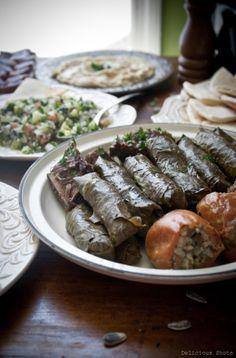 A True Middle Eastern Feast, Tabouli Salad, Grape Leaves (Warak Dawali), Hummus, & Baba Ghanoush.