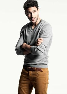 Shop this look for $82:  http://lookastic.com/men/looks/tobacco-jeans-and-brown-belt-and-grey-v-neck-sweater-and-olive-v-neck-t-shirt/734  — Tobacco Jeans  — Brown Leather Belt  — Grey V-neck Sweater  — Olive V-neck T-shirt