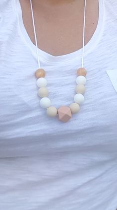 Silicone Bead Teething Necklace, Silicone Nursing Breastfeeding Necklace for Mom & Baby, in gold, white, tan, and featuring a peach hexagon silicone bead