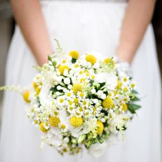 A textured white and yellow bouquet consisting of billy buttons, easter daisies, sweet peas, white freesia, white chrysanthemum, lisianthus, and baby's breath.  Read more: http://boards.weddingbee.com/topic/september-wedding-suvey/page/2#ixzz2hdJULNOv
